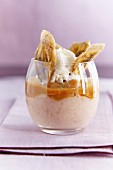 Banana dessert with banana chips and whipped cream