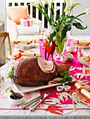 Baked ham with quince glaze on the Christmas table