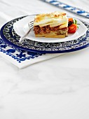 Moussaka, garnished with cherry tomatoes