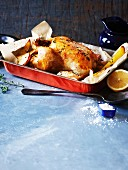 Roast chicken with lemon, thyme and potato wedges