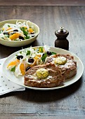Pork steaks with a herb butter and a fennel & orange salad