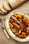 Mini sausages wrapped in bacon with sweet potatoes and bread