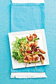 Fish skewers with prawns and vegetables, served with an Asian carrot salad
