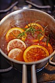 Oranges in red wine sauce with rosemary