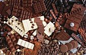 Lots of different types of chocolate, filled chocolates and cocoa powder