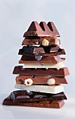 A tower of pieces of different kinds of chocolate