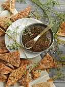 Caraway crackers with sea salt, caraway, and caraway plants