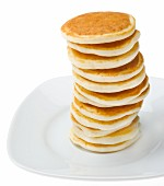 Tall Stack of Pancakes on a White Plate