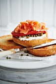 Toasted Bagel with Lox, Cream Cheese, Sliced Tomato and Capers