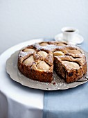 Pear and walnut cake, one slice removed