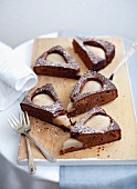 A few slices of chocolate cake with poached pears
