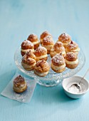 Small profiteroles filled with crème pâtissière and dusted with icing sugar