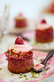 Mini raspberry cheesecakes with chopped pistachios