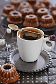A cup of espresso and mini Bundt cakes