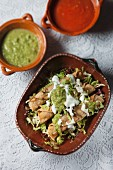 Taquitos with chicken, sour cream and guacamole (Mexico)