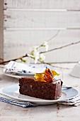 A slice of dark chocolate cake with hazelnuts