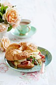 Croissant filled with ham, egg and melted cheese