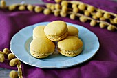 Lemon macaroons on a pale blue plate