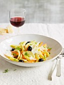 Penne with marinated spring vegetables and olives