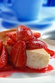 A piece of strawberry cheesecake