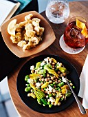 Chickpea salad with courgette flowers and breaded calamari with lemon
