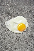 Egg yolk against asphalt
