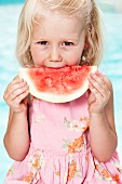 Portrait of girl eating watermelon