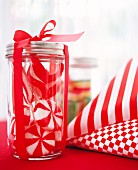 Red and white sweets in a jar