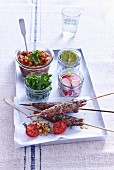 Beef skewers with aubergine dip