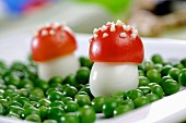 Fly agaric mushrooms made of egg and tomato, with peas