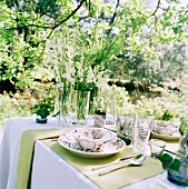A set table in a sunny garden.