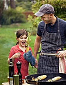 Father and daughter preparing barbecue