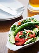 Traditional Georgian tomato cucumber salad.