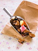 Chocolate and caramel candies on candy shovel