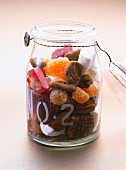 Jar with candies and candied fruits