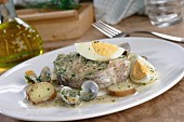 Merluza koskera (hake in a wine sauce with egg and potatoes)