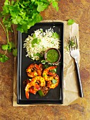 Curried prawns with a mint dip and rice
