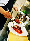 A chef fixing food.