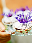Muffins with flowers, close-up.