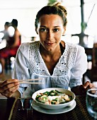 A Scandinavian woman having lunch, Thailand.