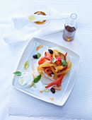 Honeydew melon with peppers and courgette, goat's cheese and basil