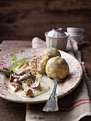 Buckwheat and bacon dumplings with mushroom sauce and thyme