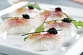 Nigiri sushi with seabream and caviar