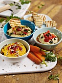 Assorted spicy houmous dips