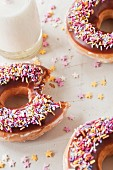 Doughnuts with chocolate glaze and colourful sugar sprinkles