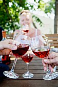 Human hands toasting with wine glasses