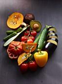 A still life featuring summer vegetables