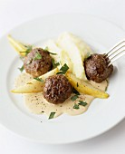Meatballs with mashed potato and pears