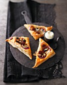 Spanish pastries with chorizo and olives