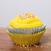 Vanilla cupcake with coloured sugar balls
